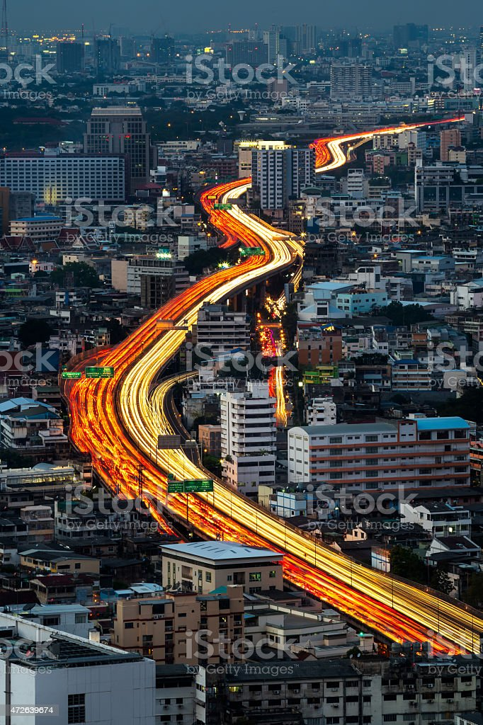 Traffic and blurred light trails in Bangkok city, Thailand