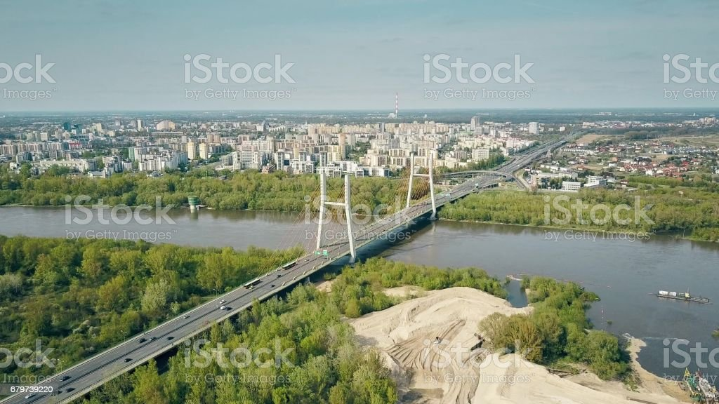 Aerial shot of Warsaw residential area, Vistula river and guyed bridge stock photo