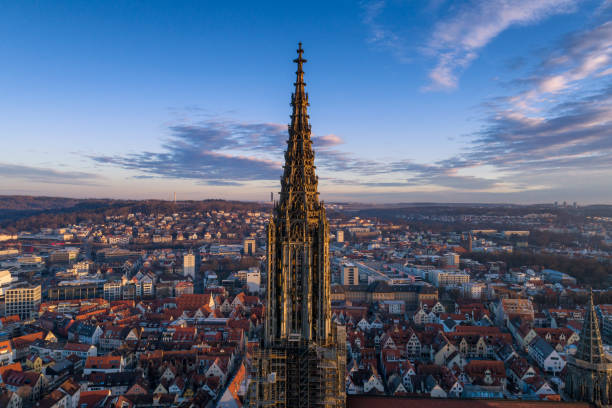 Aerial shot taken with a drone of Ulm Minster at sunrise Ulm, Germany - March 11, 2017 - Aerial shot taken with a drone of Ulm Minster at sunrise north rhine westphalia stock pictures, royalty-free photos & images