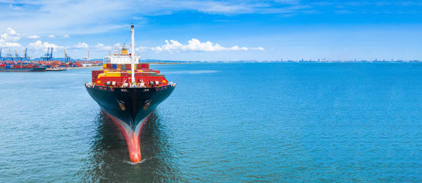 Aerial side view container ship carrying container in import export business logistic and transportation of international by container ship in the open sea, with copy space. stock photo