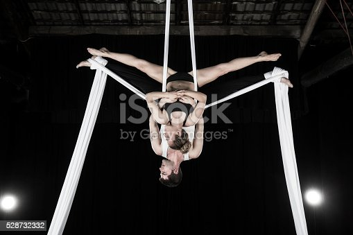 istock Aerial silk dancers 528732332