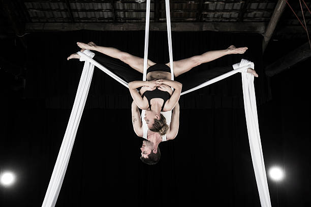 Aerial silk dancers stock photo