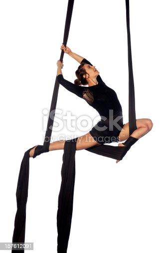 woman doing aerial exercises, studio shot.