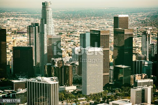The center of downtown Los Angeles, California shot from an altitude of about 1100 feet over the city.  The image was processed to blur the background of the area to allow for added interest in the buildings