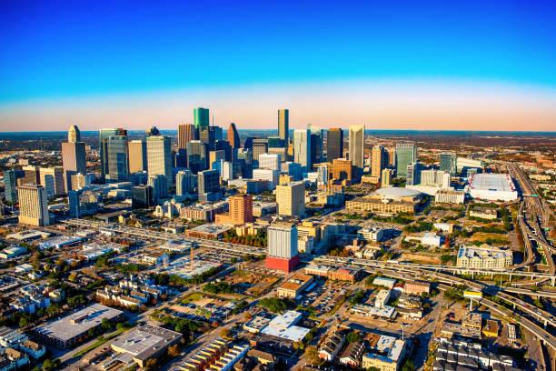 aerial skyline von houston, texas - flugzeugperspektive stock-fotos und bilder
