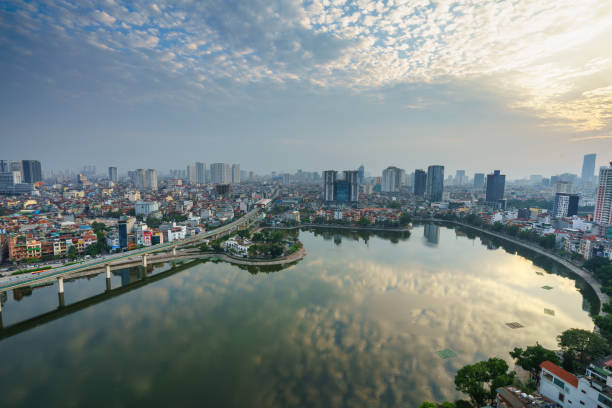 Aerial skyline view of Hanoi city, Vietnam. Hanoi cityscape by sunset period at Hoang Cau lake, Dong Da district Aerial skyline view of Hanoi city, Vietnam. Hanoi cityscape by sunset period at Hoang Cau lake, Dong Da district hanoi stock pictures, royalty-free photos & images