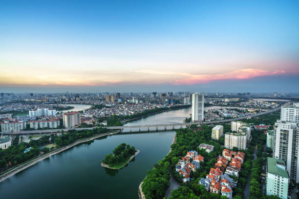 Aerial skyline view of Hanoi cityscape at twilight. Linh Dam peninsula, Hoang Mai district, Hanoi, Vietnam Aerial skyline view of Hanoi cityscape at twilight. Linh Dam peninsula, Hoang Mai district, Hanoi, Vietnam hanoi stock pictures, royalty-free photos & images