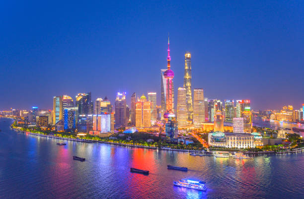 Aerial skyline view of Shanghai at dusk Aerial skyline view of Shanghai at dusk showing the financial district of Pudong and its tall skyscrapers. pudong stock pictures, royalty-free photos & images