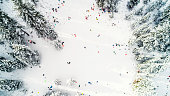 Aerial drone photo, directly above sledding near Lake Tahoe on the Nevada side of the mountainous, pristine lake resort area during winter after a fresh snowstorm.