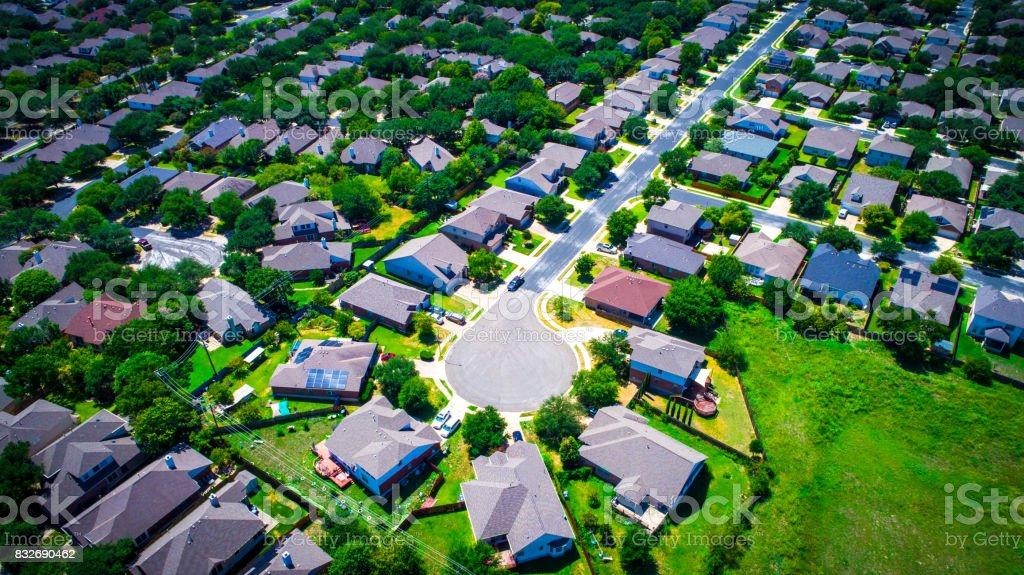 aerial suburb austin texas green summertime looking down from above vast neighborhood suburban community royalty