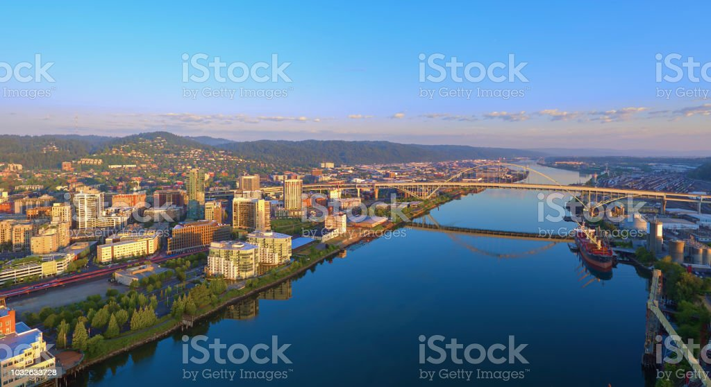 Aerial sunrise of the Fremont Bridge and the waterfront in downtown Portland Oregon on a sunny summer day stock photo