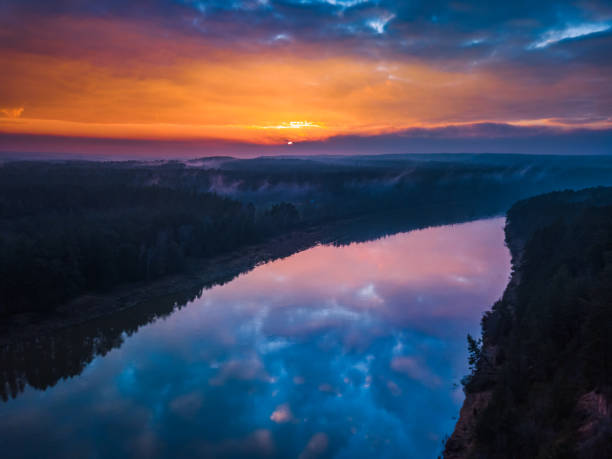Aerial sunrise or sunset with fog and river Aerial sunrise or sunset with colorful fog and river reincarnation stock pictures, royalty-free photos & images