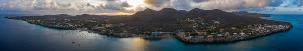 Aerial sunrise view of coast of Curaçao in the Caribbean Sea with turquoise water and cliff around Westpunt stock photo
