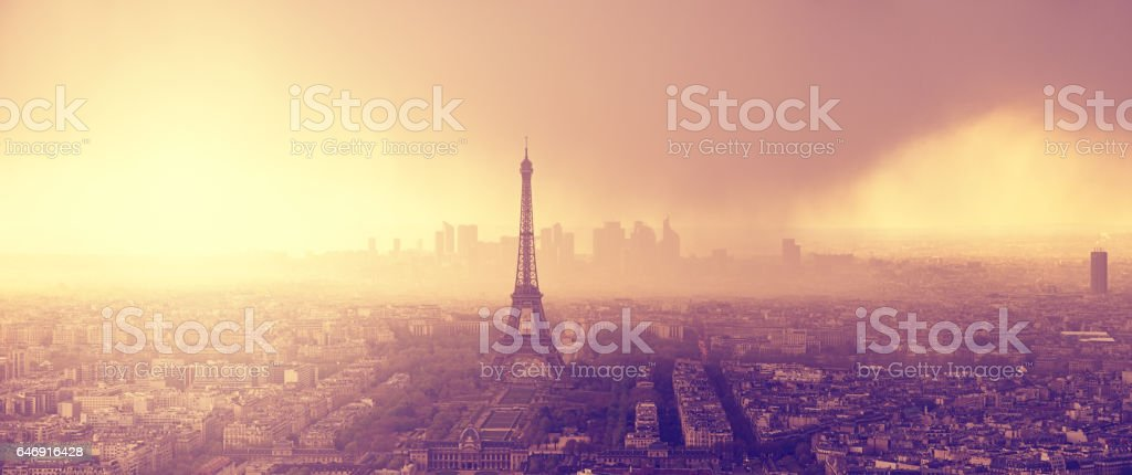 Aerial Sunset Panorama of Paris with Dramatic Storm Clouds stock photo