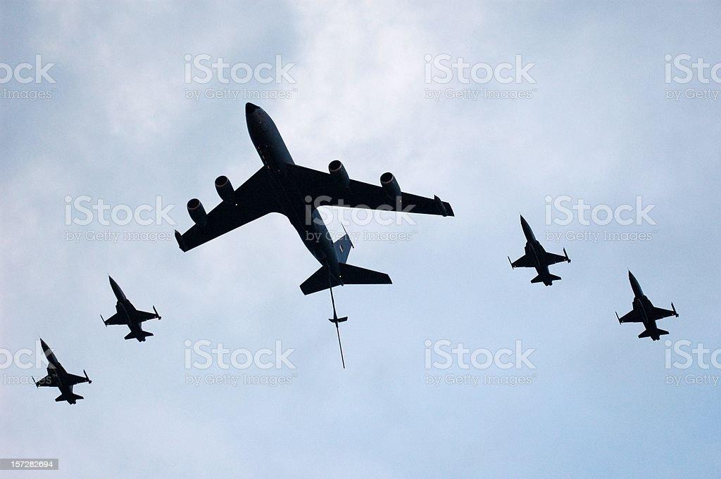 Aerial tanker & jet fighers stock photo