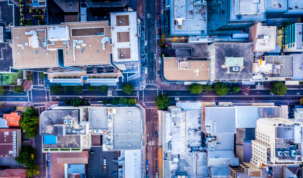Aerial top down view of city streets, buildings and rooftops stock photo