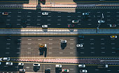 istock Aerial Top Down View of City Traffic on a Highway 1217400083