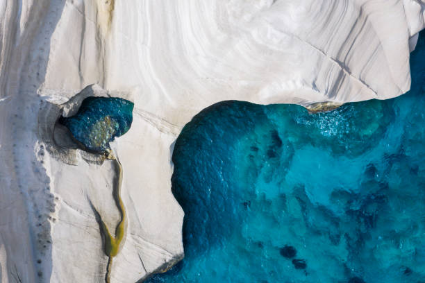 Aerial top down view to the chalk rock formations of Sarakiniko, Milos island, Cyclades, Greece stock photo