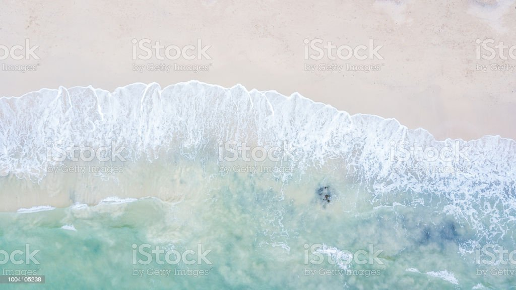Aerial top view beautiful sea landscape, beach and wave with turquoise sea water with copy space stock photo