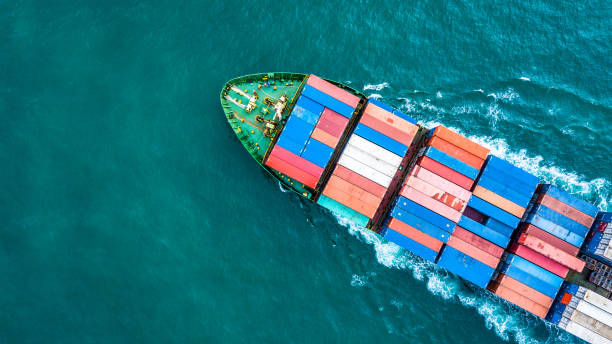 Aerial top view container cargo ship, Business logistic and transportation of International by ship in the open sea. Aerial top view container cargo ship, Business logistic and transportation of International by ship in the open sea. container ship stock pictures, royalty-free photos & images