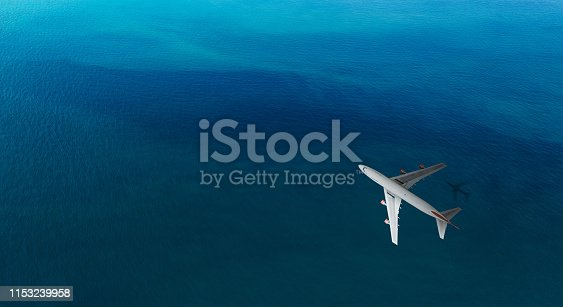 1058205304 istock photo Aerial top view of Airplane flies over a sea 1153239958