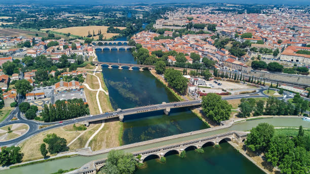 Aerial top view of Beziers town, river and bridges from above, South France stock photo