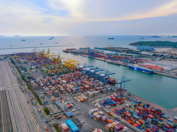 Aerial top view of container cargo ship in the export and import business and logistics international goods in urban city. Shipping to the harbor by crane in Laem Chabang, Chon Buri, Thailand stock photo