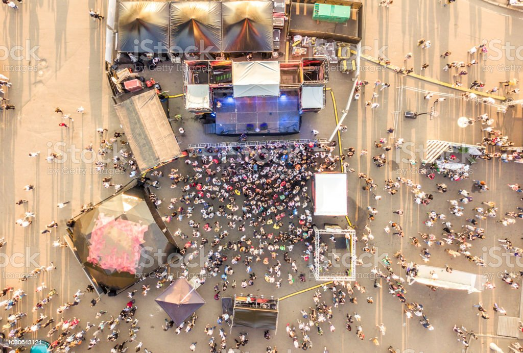 aerial top view of crowd of people standing near the stage on concert on summer day royalty-free stock photo