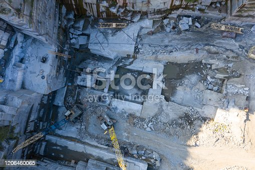 istock Aerial top view of crushing machinery, conveying crushed granite gravel stone in quarry open pit mining. Processing plant for crushed stone and gravel. Mining and Quarry mining equipment. 1206460065