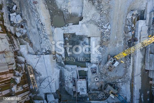 istock Aerial top view of crushing machinery, conveying crushed granite gravel stone in quarry open pit mining. Processing plant for crushed stone and gravel. Mining and Quarry mining equipment. 1206461331