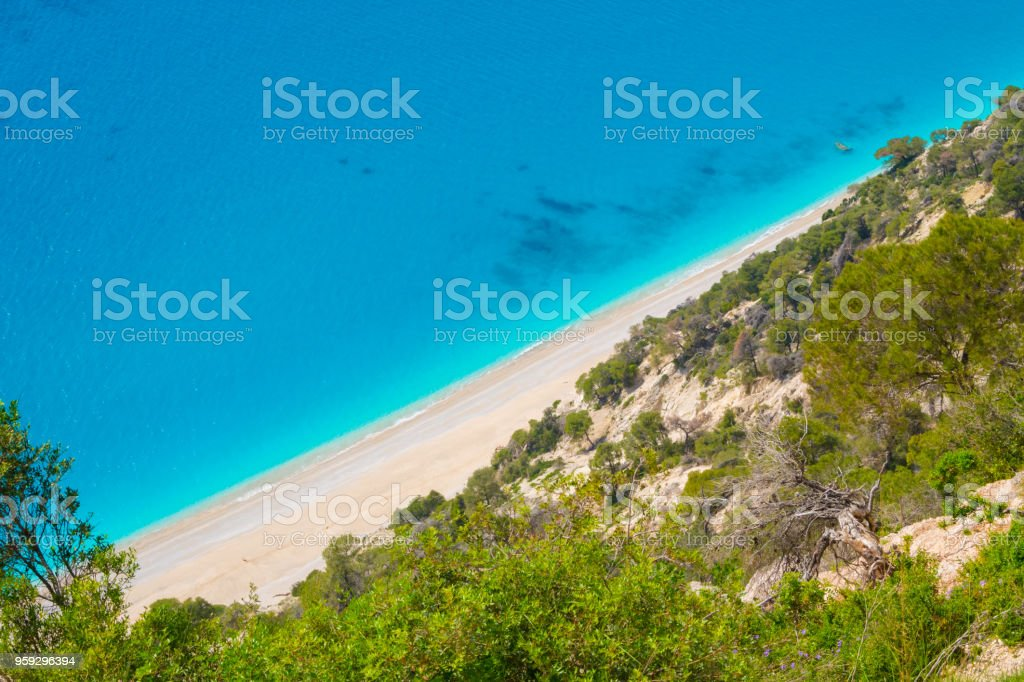 Aerial top view of Egremnoi beach with crystal clear turquoise sea waters in Lefkada island in Greece stock photo
