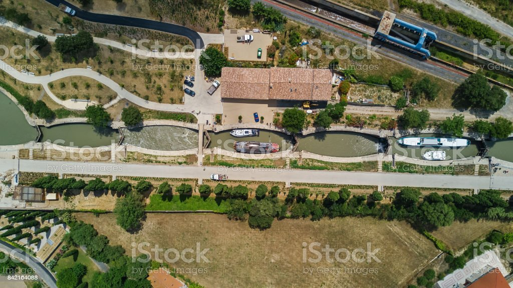 Aerial top view of Fonserannes locks on canal du Midi from above, unesco heritage landmark in France stock photo