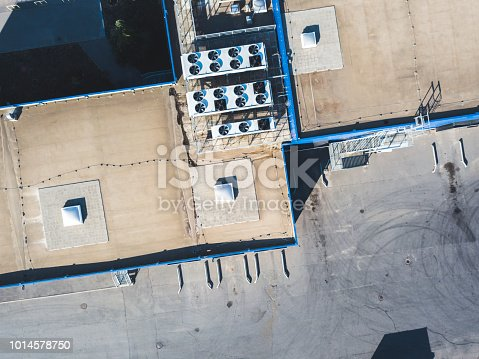 istock aerial top view of industrial technical system machines on the rooftop of hangar building 1014578750