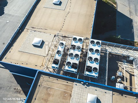 istock aerial top view of industrial technical system machines on the rooftop of hangar building 1014578764