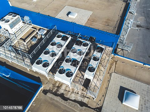 istock aerial top view of industrial technical system machines on the rooftop of hangar building 1014578766