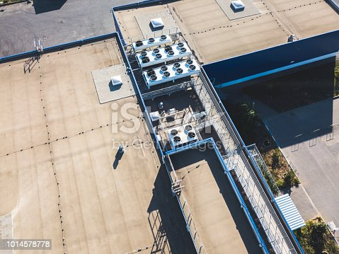 istock aerial top view of industrial technical system machines on the rooftop of hangar building 1014578778