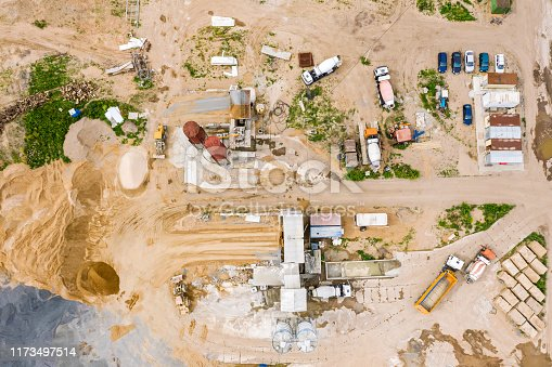 istock aerial top view of mix concrete production plant with working trucks 1173497514