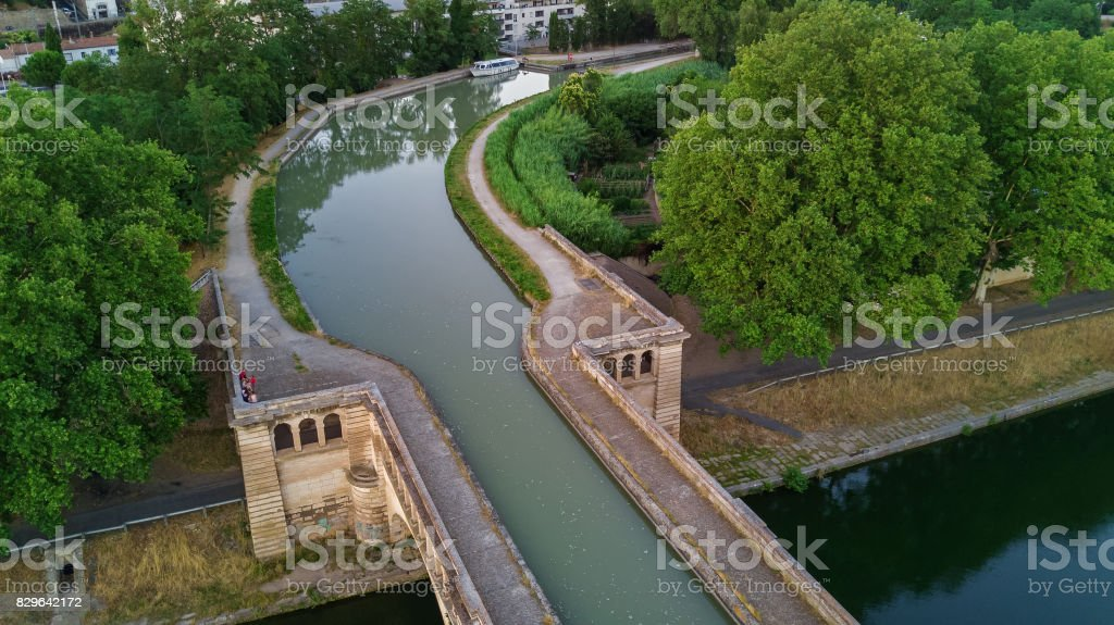 Aerial top view of river, canal du Midi and bridges from above, Beziers town, South France stock photo