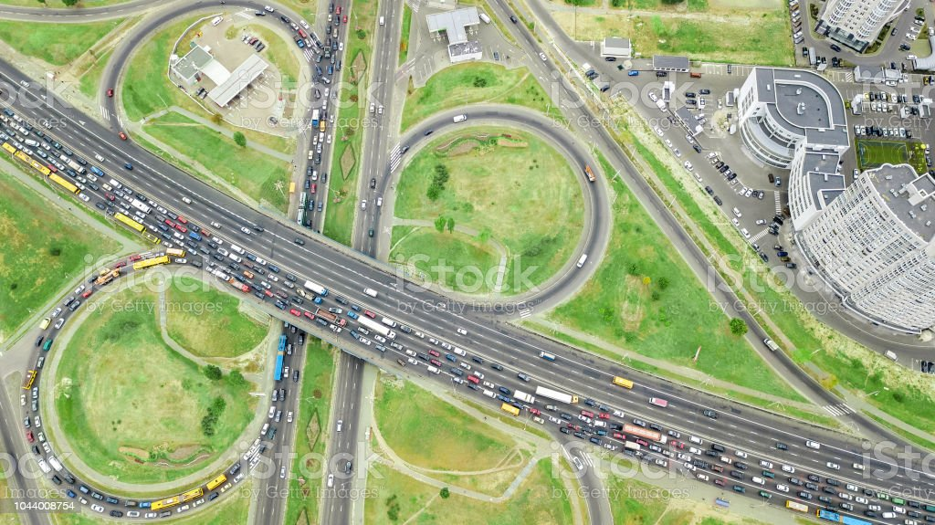 Aerial top view of road junction from above, automobile traffic and...