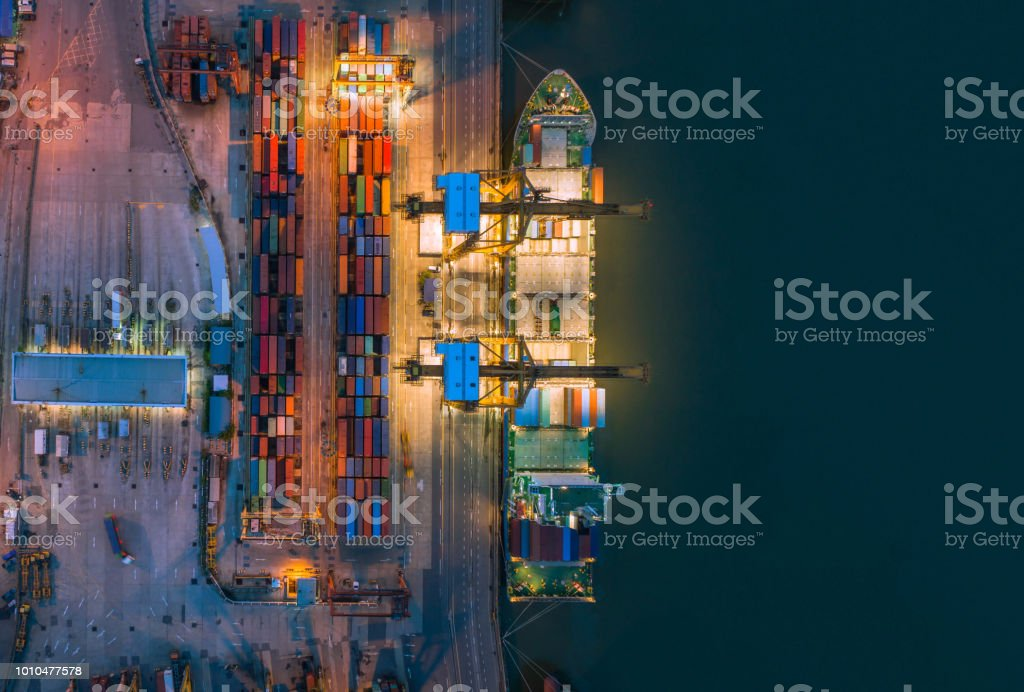 Aerial top view of ship containers at shipping port for international...