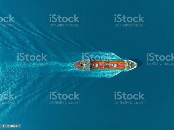 Photo of Aerial top view Oil ship tanker carier oil from refinery on the sea.