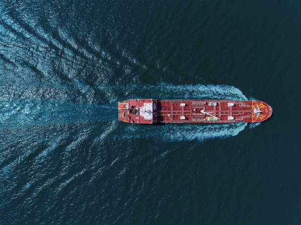 aerial top view oil tanker ship transportation oil from refinery with beautiful wave on the sea. - nave foto e immagini stock