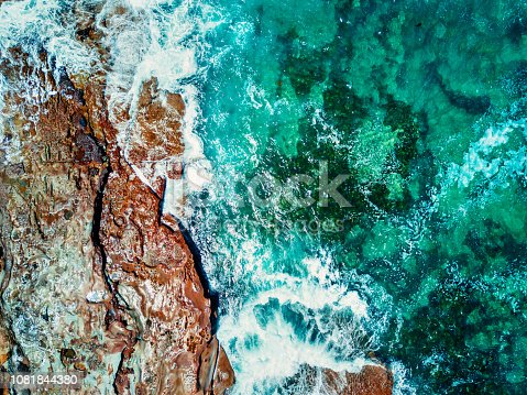 Aerial views of the  ocean and rocks of Durras, Australia, showing beautiful rock textures