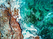 Aerial topdown viewws of ocean and rocks Durras, Australia