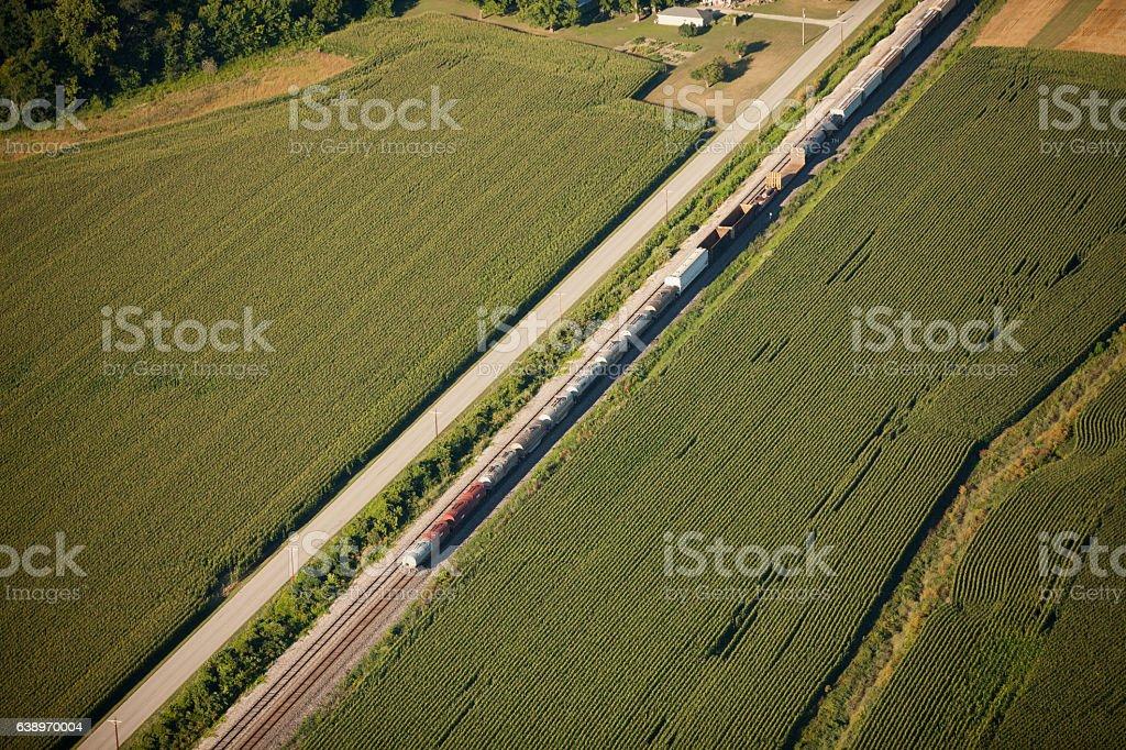 Aerial Train Through Farm Fields stock photo