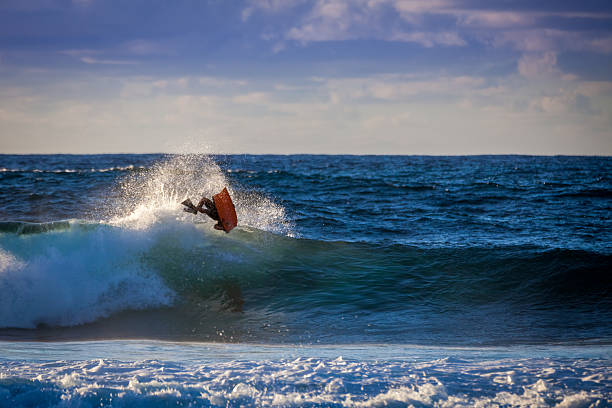 Aerial trick of a bodyboarder stock photo