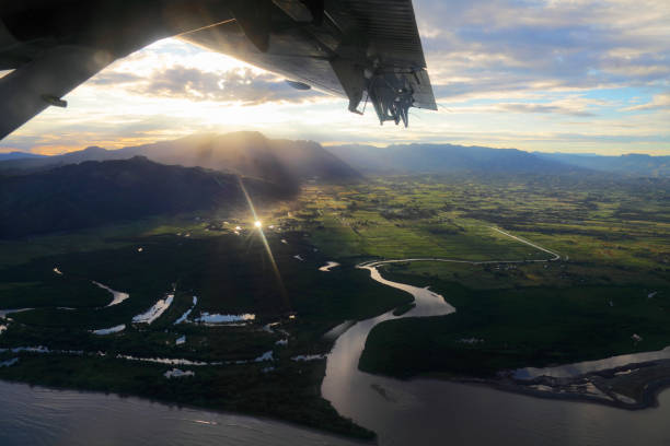 Aerial tropical mountains with a river stock photo