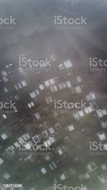 Aerial view  about the cemetery on a foggy morning In Sic village, Transyvania, Romania.