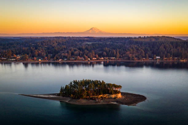 Aerial View Above Cutts Island AKA Deadmans Island Puget Sound WA An aerial view of Cutts Island with Mt Rainier in the background at golden hour Puget Sound Washington puget sound stock pictures, royalty-free photos & images