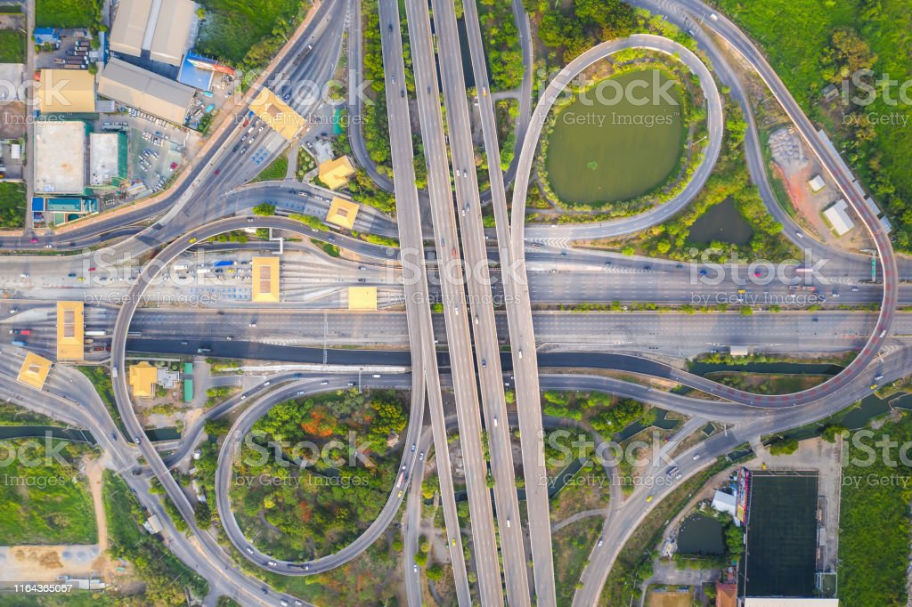 Aerial View Above of Busy Highway Road Junctions at day. The...